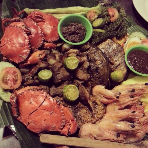 (Clockwise from top left): Crabs, lato, shrimp, fish buried under pork.