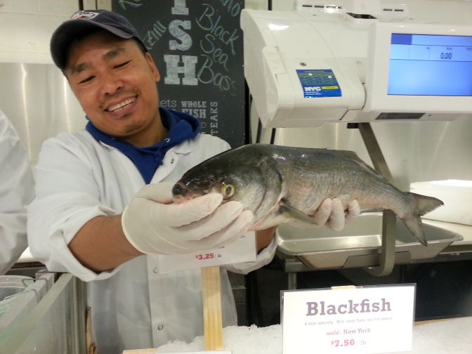 The fishmonger insisted the fish be smiling for the picture