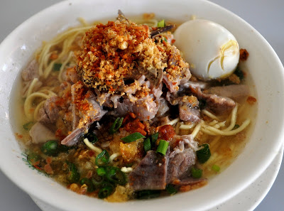 Batchoy (Miki noodles in a pork broth topped with pork organs, leeks, chicharon, and an egg) courtesy of the original Ted's La Paz Batchoy in Iloilo.