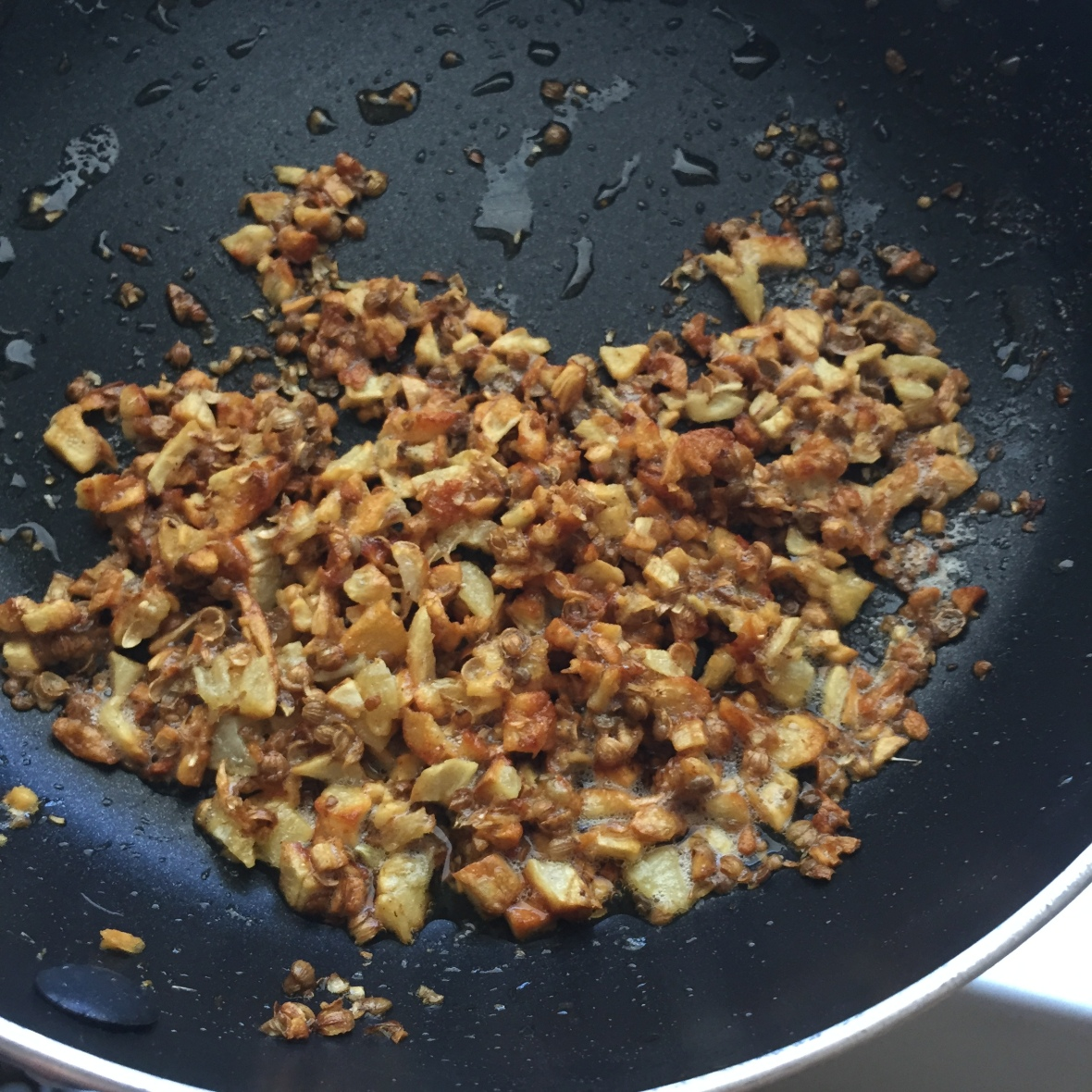 Taqliyah: A mixture of fried minced garlic and coriander seeds